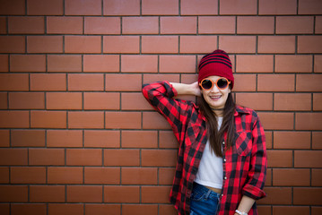Portrait asian hipster girl on brick wall background,Lifestyle of thailand people