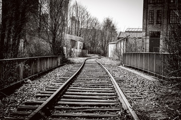 Railroad tracks going through an abandoned city
