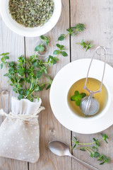 Thyme tea and sprigs of thyme