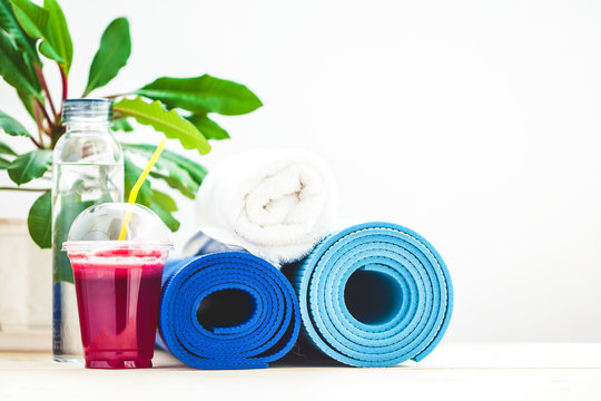 set for sports, a yoga mat, a towel, smoothies , bottle of water The concept of a healthy lifestyle Copy space