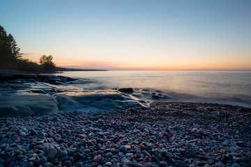 horizontal image, sunrise on Lake Superior in northern Minnesota USA.
