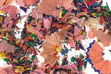 Shavings from multicolored pencils as background. Top view.
