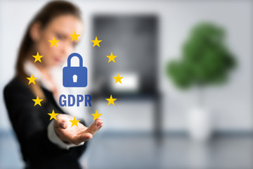 businessman is presenting GDPR in front of an office scene