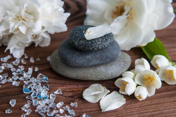 Acrylic Prints Pyramids of gray zen stones with beautiful fresh white flowers. Concept of harmony, balance and meditation, spa, massage, relax