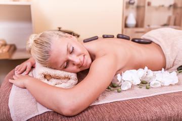 Woman Getting Stones Massage