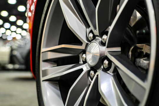 Close up of rims from a sports car. The concept of tuning the wheels of a car. Car wheel.