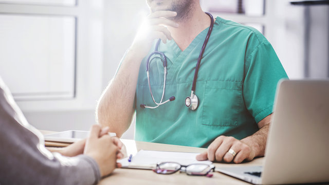 The doctor talking with patient