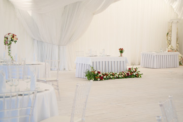 luxury airy summer restaurant in white with transparent chairs and ready to party