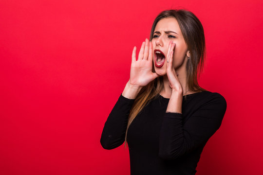 Portrait woman shouting over red background