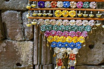 Handmade floral decoration in buddhist temple. Cambodian temple interior floral decor. Buddhism festival decoration. Fototapete