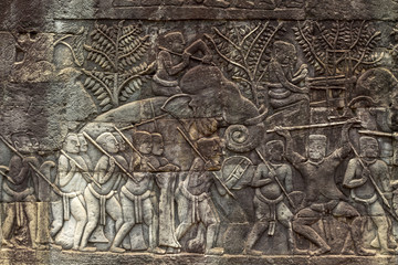 Ancient stone bas-relief in Bayon temple. Cambodia tourist photo. Ancient temple detail.