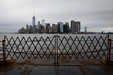 The skyline of lower Manhattan is seen from the Staten Island ferry in New York Harbor in New York City