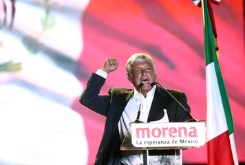 Mexican presidential candidate Andres Manuel Lopez Obrador addresses supporters during his closing campaign rally at the Azteca stadium, in Mexico City