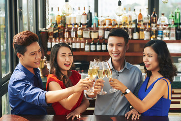 Young people clebrating something in bar
