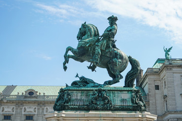 Statue of Emperor Joseph II with horse lifting two leg in front of Hofburg Palace Vienna Austria.