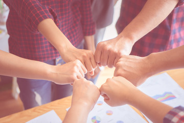 Four hand together in business meeting for team concept
