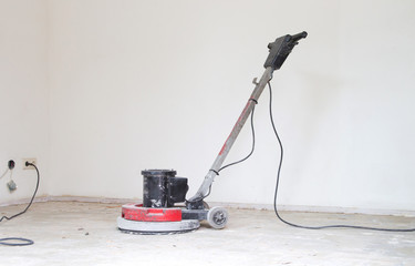 Concrete surface sanding machine