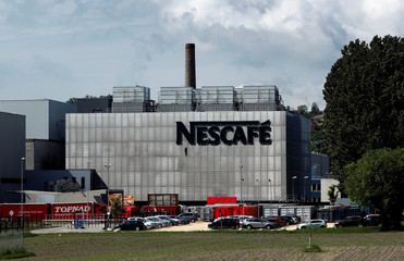 A Nescafe logo is pictured on a coffee factory at Nestle in Orbe