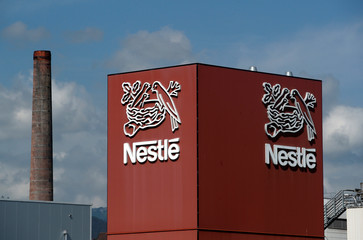 A Nestle logo is pictured on a coffee factory in Orbe