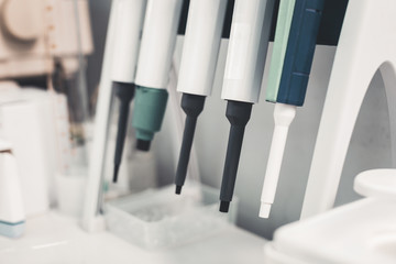 Hospital. Close up of blood pipette equipment of high quality being set in laboratory room