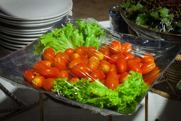 Foto op Aluminium Buffet, Bar Vegetable salad on plastic wrap for buffet line in wedding party.