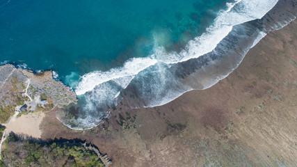 Aerial top view of beautiful ocean waves at Nusa Dua Beach, Bali in Indonesia
