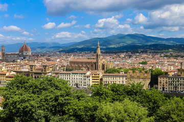 Wonderful summer cityscape of Florence with clouds in background, Italy. Concept of italian photos for postcards and last minute tours to Europe.