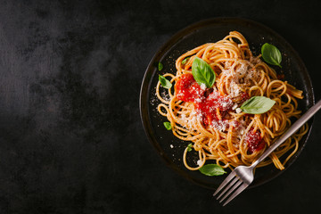 Dark plate with italian spaghetti on dark Wall mural