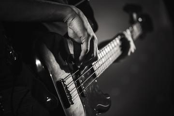 Electric bass guitar player hands, live music