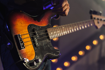 Bass guitar in guitarist hands