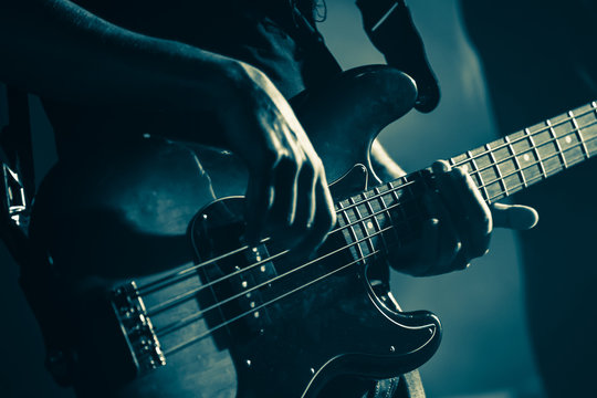 Electric bass guitar player hands, live music