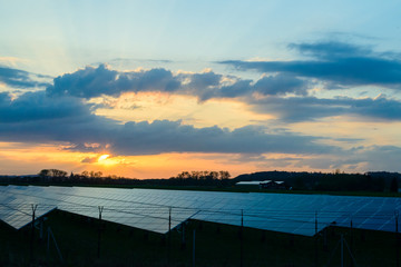 Solar panel at sunset background. Alternative electricity