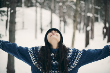 Young woman relaxing in snowy forest