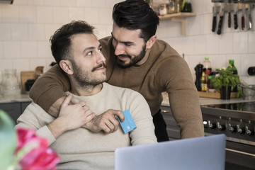 Gay couple making online payment