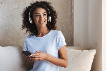 Happy african woman in headphones