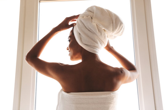Back view of a sensual african woman