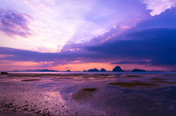 Background image of the colorful seascape in summer time. Beautiful sunset sky over the low tide at tropical beach in the evening with filter. copy space. Tup Kaek Beach, Krabi, South of Thailand.