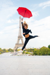 Fashion woman jump with umbrella. Happy woman travel in paris, france. Girl with beauty look at eiffel tower. Travelling and wanderlust. Parisian isolated on white background. Enjoy summer vacation
