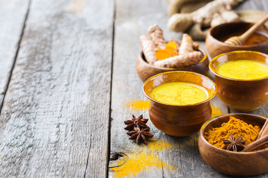 Traditional indian drink turmeric curcuma golden milk with ingredients