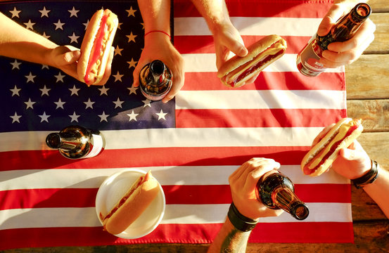 4th of July celebration party, young men hands holding beer bottle, holiday label design, Happy Independence day, hot dog, mustard, catchup. American flag, river recreation area. Close up, background