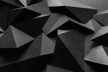 Dark composition with black geometric shapes, abstract background