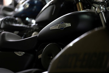 The Harley Davidson logos are seen on a motorcycle at a showroom in Bangkok