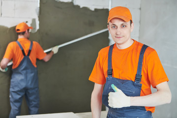 plaster service. portrait of male plasterer