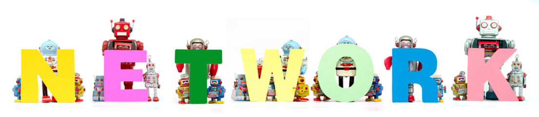 retro tin robot toys hold up the word  NETWORK