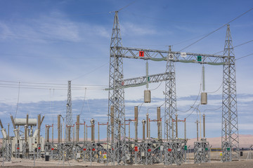 Power Lines and Susbstations in the middle of the desert for renewable energy generation