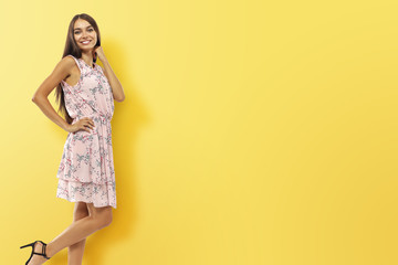 Woman on yellow wall and free space for your decoration.