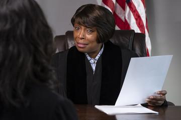A judge presiding over a case in courtroom