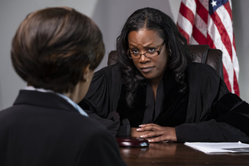 A judge listening to lawyer in court
