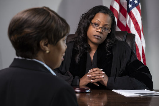 A judge deliberating a court case