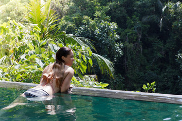 girl in the tropic jungle pool